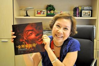 Kechara House President Dato May Phng holding a copy of the Chinese Vajrayogini book.